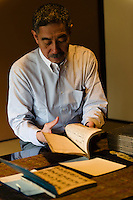"""Tokubee Masuda, CEO of the Tsukinokatsura sake brewery. He is looking at a historic document describing the brewing of koshu matured sake. Fushimi, Kyoto, Japan, October 10, 2015. Tsukinokatsura Sake Brewery was founded in 1675 and has been run by 14 generations of the Masuda family. Based in the famous sake brewing region of Fushimi, Kyoto, it has a claim to be the first sake brewery ever to produce """"nigori"""" cloudy sake. It also brews and sells the oldest """"koshu"""" matured sake in Japan."""