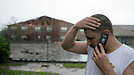 Greg Ledet talks on the phone at the Chateau Creole Apartments in Houma, Louisianna which were heavily damaged as Hurricane Gustav passes through September 1, 2008.    (Mark Wallheiser/TallahasseeStock.com)