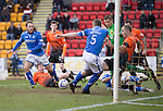 St Johnstone v Dundee United.....29.12.13   SPFL<br /> Sean Dillon clears the ball from the box after a goal line scramble with Stevie May and Frazer Wright<br /> Picture by Graeme Hart.<br /> Copyright Perthshire Picture Agency<br /> Tel: 01738 623350  Mobile: 07990 594431