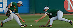 University of Miami outfielders Jon Jay and Tommy Giles have a ball fall between them in the bottom of the first inning..(Chris Machian/Prairie Pixel Group)