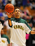 13 February 2011: University of Vermont Catamount forward Luke Apfeld, a Freshman from Wolfeboro, NH, warms up prior to facing the Binghamton University Bearcats at Patrick Gymnasium in Burlington, Vermont. The Catamounts came from behind to defeat the Bearcats 60-51 in their America East matchup. The Cats took part in the National Pink Zone Breast Cancer Awareness Program by wearing special white jerseys with pink trim. The jerseys were auctioned off following the game with proceeds going to the Vermont Cancer Center. Mandatory Credit: Ed Wolfstein Photo