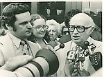Attorney Bernard Avcollie (left), and his attorney, Theodore Koskoff, talk with reporters outside Superior Court after Avcollie was cleared of a charge of murdering his wife.21 July 1977