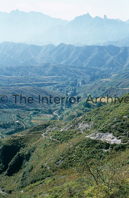View across a fertile valley to the high peaks of the Yan Shan mountain range