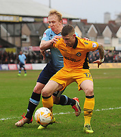 Newport County's Scot Bennett under pressure from Blackpool's Mark Cullen<br /> <br /> Photographer Kevin Barnes/CameraSport<br /> <br /> The EFL Sky Bet League Two - Saturday 18th March 2017 - Newport County v Blackpool - Rodney Parade - Newport<br /> <br /> World Copyright &copy; 2017 CameraSport. All rights reserved. 43 Linden Ave. Countesthorpe. Leicester. England. LE8 5PG - Tel: +44 (0) 116 277 4147 - admin@camerasport.com - www.camerasport.com