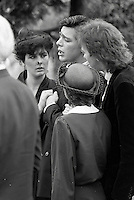 Pix: Copyright Anglia Press Agency/Archived via SWpix.com. The Bamber Killings. August 1985. Murders of Neville and June Bamber, daughter Sheila Caffell and her twin boys. Jeremy Bamber convicted of killings serving life...copyright photograph>>Anglia Press Agency>>07811 267 706>>.A weeping Jeremy Bamber is comforted by his girlfriend Julie Mugford at the funeral of his family, alongside Colin Caffell, father and husband of victims. no date..ref 0006 neg 14.