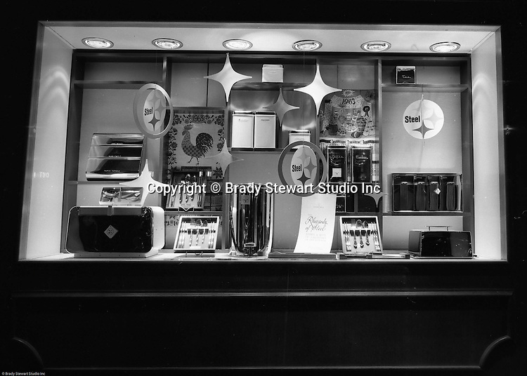 Pittsburgh PA: View of Christmas window display at Horne's department store in Pittsburgh. Steel silverware, phonograph, and other steel products for the home on display during the Rhapsody of Steel campaign.  US Steel launched an awareness campaign of all the current uses of steel in everyday products.  During this time, ALCOA Aluminum Company of America also headquartered in Pittsburgh, was aggressively competing to enter markets where US  steel companies traditional dominated market share. Examples included beer and food Cans, appliances, automobile parts, children toys / bicycles, and more.