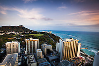 A view at sunset of Diamond Head and Waikiki Beach from the top of the Waikiki Beach Marriott Resort & Spa on O'ahu.