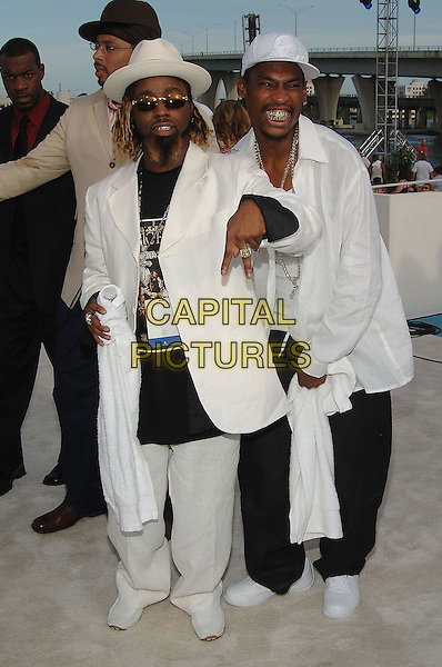 YING YANG TWINS.MTV Video Music Awards.Arrivals held at the American Airlines Arena,.Miami, 28th August 2005.full length white suit hat cap sunglasses fingers beard.Ref: ADM/JW.www.capitalpictures.com.sales@capitalpictures.com.© Capital Pictures.
