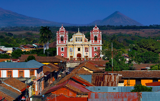 The 18th century El Calvario Church rises above the city of Leon, and the very active Cerro Nego Volcano rises in the distance.