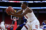 03 November 2016: NC State's Dennis Smith, Jr. grabs a rebound. The North Carolina State University Wolfpack hosted the Lynn University Fighting Knights at PNC Arena in Raleigh, North Carolina in a 2016-17 NCAA Division I Men's Basketball exhibition game. NC State won the game 100-66.