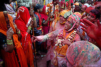 A man taunts a girl by folk song generally used during holi to make her angry. The lyrics of the songs generally have sexual connotation, which makes the girl angry. As holi itself is played among men and women but only in Barsana holi is still celebrated in the way its written in the epics. Barsana, Uttarpradesh, India