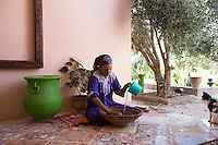 Morocco - Tidzi - Saadia Tighanimine, 49, prepares argan oil. Saadia comes from the village of Idmine. A mother of 4 kids aged between 18 and 10, Tighanimine joined Ajddigue in 2010. During the summer harvesting season, the woman wakes up at 5am and spends her whole day in the argan forest. She can collect up to 280 kilos of argan fruit per day. Her activity in the cooperative earns her around 100 euros per month, a vital amount for her family.