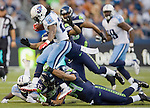 Tennessee Titans' running back Chris Johnson is tackled for a two-yard loss by Seattle Seahawks' strong safety Roy Lewis at CenturyLink Field in Seattle, Washington on August 11, 2012. ©2012. Jim Bryant Photo. All Rights Reserved...
