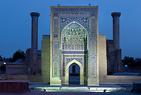 Low angle view of  monumental arch, Gur-Emir Mausoleum, 1417-20, Samarkand, Uzbekistan, pictured on July 14, 2010, floodlit at night. Gur-Emir Mausoleum, or Tomb of the Ruler, was built by Timur in 1404 for his favourite grandson, Mohammed Sultan, and became the mausoleum for the Timurid dynasty. Samarkand, a city on the Silk Road, founded as Afrosiab in the 7th century BC, is a meeting point for the world's cultures. Its most important development was in the Timurid period, 14th to 15th centuries. Picture by Manuel Cohen.