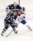 Brett Kostolansky (UNH - 15), Josh Holmstrom (Lowell - 12) - The visiting University of New Hampshire Wildcats defeated the University of Massachusetts-Lowell River Hawks 3-0 on Thursday, December 2, 2010, at Tsongas Arena in Lowell, Massachusetts.