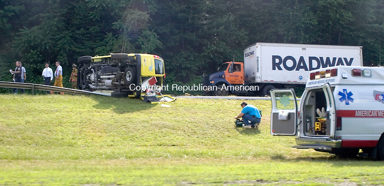 WATERTOWN, CT- 30 JUNE 2008- 063008JT04-<br /> Emergency workers respond to a rolled over Service Master Clean van on Route 8 southbound on Monday afternoon in Watertown.<br /> Josalee Thrift / Republican-American