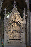 Funerary monument of Dagobert (603 - 639), depicting the legend of John the Hermit, stone, circa 1264, gisant of Dagobert and statues of Nanthild, his wife and Clovis II, his son are 19th century reproductions, Abbey church of Saint Denis, Seine Saint Denis, France. Picture by Manuel Cohen