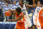 21 December 2007: Duke's Keturah Jackson (31) slaps the ball away from Bucknell's Kesha Champion (25). The Duke University Blue Devils defeated the Bucknell University Bisons 92-49 at Cameron Indoor Stadium in Durham, North Carolina in an NCAA Division I Women's College Basketball game.