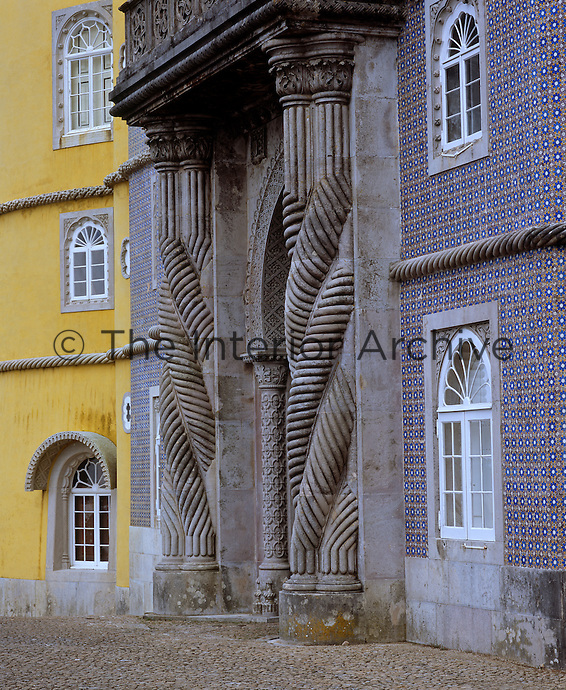 Moorish geometric tiles cover the walls surrounding this neo-Manueline portico at the main entrance to the palace