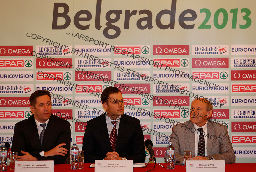 BELGRADE, SERBIA - DECEMBER 07: President of European Athletics Hansjorg Wirz, President of the Belgrade city Sinisa Mali (C) and President of Serbia Athletics Federation Veselin Jevrosimovic (L) talks to the media during a press conference for the 20th SPAR European Cross Country Championships at the Belgrade City Hall on December 7, 2012 in Belgrade, Serbia. (Photo by Srdjan Stevanovic/Getty Images)