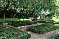 The parterres, surrounded by low-clipped box hedging, have been arranged in a formal yet pleasingly simple design
