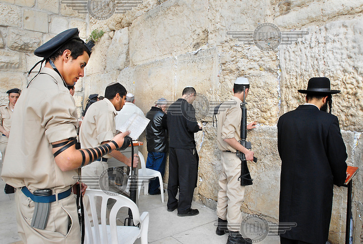 Israeli soldiers praying at the Western Wall (also known as the Wailing Wall or The Kotel).