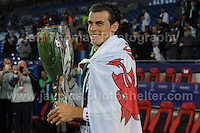 Cardiff City Stadium, Cardiff, South Wales - Tuesday 12th Aug 2014 - UEFA Super Cup Final - Real Madrid v Sevilla - <br /> <br /> Real Madrid&rsquo;s Gareth Bale with the UEFA 2014 Super Cup 2014 and wears his National flag with pride. <br /> <br /> <br /> <br /> <br /> Photo by Jeff Thomas/Jeff Thomas Photography