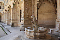 Font with a lion in the corner of the Cloister, built in Manueline style by Diogo Boitac, Joao de Castilho and Diogo de Torralva, completed 1541, in the Jeronimos Monastery or Hieronymites Monastery, a monastery of the Order of St Jerome, built in the 16th century in Late Gothic Manueline style, Belem, Lisbon, Portugal. The cloister wings have wide arcades with rectangular column and tracery within the arches. The monastery is listed as a UNESCO World Heritage Site. Picture by Manuel Cohen