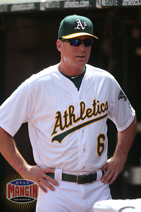 OAKLAND, CA - APRIL 9:  Manager Bob Melvin #6 of the Oakland Athletics watches from the dugout against the Texas Rangers during the game at O.co Coliseum on Thursday, April 9, 2015 in Oakland, California. Photo by Brad Mangin