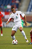 Guadeloupe midfielder David Fleurival (6) dribbles the ball during the CONCACAF soccer match between Panama and Guadeloupe at Ford Field Detroit, Michigan.