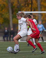Boston College forward/midfielder Gibby Wagner (10) passes the ball as Marist College midfielder Kathryn Hannis (2) pressures.  Boston College defeated Marist College, 6-1, in NCAA tournament play at Newton Campus Field, November 13, 2011.