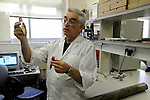 Harold Vinegar, Chief Scientist of Israel Energy Initiatives (IEI), holds vials of oil generated by heating an oil shale to 350 C, at the Geology Department of Ben Gurion University, Be'er Sheva, southern Israel.