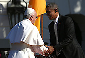 U.S. President Barack Obama (R) shakes hands with Pope Francis (L) during the arrival ceremony at the White House on September 23, 2015 in Washington, DC. The Pope begins his first trip to the United States at the White House followed by a visit to St. Matthew's Cathedral, and will then hold a Mass on the grounds of the Basilica of the National Shrine of the Immaculate Conception.  <br /> Credit: Win McNamee / Pool via CNP