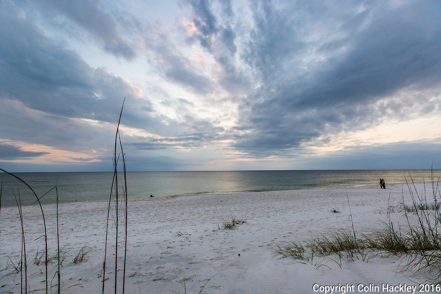 CAPE SAN BLAS, FLA. 4/15/16-A couple walks just after sunset at T. H. Stone Memorial St. Joseph Peninsula State Park on Cape San Blas, Fla.<br /> <br /> COLIN HACKLEY PHOTO