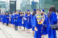 Graduating students from the Fashion Institute of Technology wait to enter Jacob Javits Convention Center in New York on Thursday, May 19, 2016 for the college's commencement exercises.  (© Richard B. Levine)