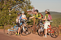 A young boy mountain biker shakes hands with an adult rider after meeting at the On the Edge trail in Copper Harbor Michigan.