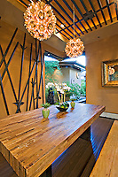 Asian inspired dining room features opening glass walls