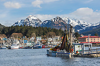 Commercial fishermen for the Herring sac roe fishery stage net for repairs on dock in Sitka, Alaska.
