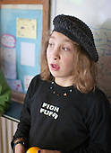 One of the young students, Summerhill School, Leiston, Suffolk. The school was founded by A.S.Neill in 1921 and is run on democratic lines with each person, adult or child, having an equal say.  You don't have to go to lessons if you don't want to but could play all day.  It gets above average GCSE exam results.