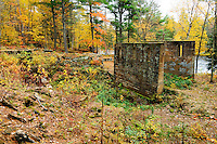 The ruins of the rock crusher building stand amoung Autumn colored trees at Banning State Park near Sandstone, Minnesota.