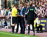 Hearts v St Johnstone...04.08.12.Steve Lomas gets a lecture by ref Stevie O'Reilly after he sent Gregory Tade off.Picture by Graeme Hart..Copyright Perthshire Picture Agency.Tel: 01738 623350  Mobile: 07990 594431