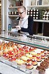 Saleswoman at work at Angelina, Rivoli Street, Rue de Rivoli, Paris, France, Europe
