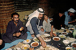 Marsh Arabs. Southern Iraq. Circa 1985. Banquet taking place in traditional village reed constructed building called a Mudhif. Only male members of community attended.