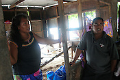 Tiaon Bwere and his wife, of Betio village, in their home which was smashed the previous day by the 'king tides' which came ashore on the Pacific island of Kiribati. Their property was damaged by the large waves, and they now face the prospect of rebuilding their home. They wish to seek assistance from the government of Kiribati.