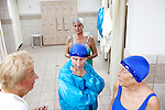 Members of the Sun City Aqua Suns, a synchronized swim team made up of retirees, wait in a locker room at the Lakeview Recreation Center before a performance at the Holiday Around the World celebration in Sun City, Arizona December 10, 2010...2010 marks the 50th anniversary of Sun City, America's first retirement city that remains the largest today with more than 40,000 residents 55 and older.