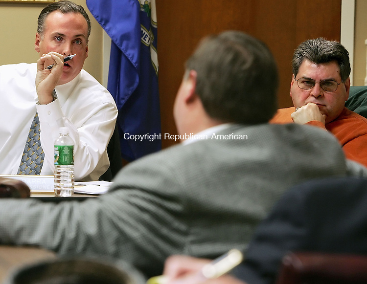 MIDDLEBURY, CT -09 January 2005 -010906JS03---Middlebury Police Commissioner member Mark Brennan, left, talks with Police Chief Patrick Bona, center, as fellow commissioner member Ralph Barra, right, looks on during  Monday's police commissioner meeting at Middlebury Town Hall. One of the items on the meeting agenda was the status of Police Chief Patrick Bona, who is on paid leave.   Jim Shannon Republican American --  Mark Brennan; Middlebury; Ralph Barra; Patrick Bona are CQ