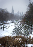 A snowy view from across the canal of Canada's parliment.