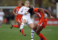 COLLEGE PARK, MD - OCTOBER 28, 2012:  Alex Reed (7) of the University of Maryland runs into Blake Stockton (29) of Miami during an ACC  women's tournament 1st. round match at Ludwig Field in College Park, MD. on October 28. Maryland won 2-1 on a golden goal in extra time.