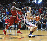 "Mississippi's Marshall Henderson (22) goes in for a dunk as Arkansas' Mardracus Wade (1) defends at the C.M. ""Tad"" Smith Coliseum on Saturday, January 19, 2013. (AP Photo/Oxford Eagle, Bruce Newman)"