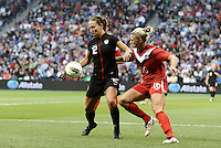 USWNT midfielder Lauren Cheney (12) holds off the challenge of  Lauren Seeselmann (16) Canada.....USWNT played to a 1-1 tie with Canada at LIVESTRONG Sporting Park, Kansas City, Kansas.